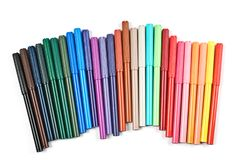 Colored felt tip pens on white. Colored felt tip pens in a row on white background royalty free stock photography