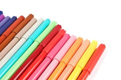 Colored felt tip pens on white. Colored felt tip pens in a row on white background royalty free stock photos