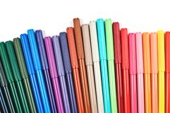 Colored felt tip pens on white. Colored felt tip pens in a row on white background stock photos