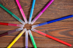 Colored felt-tip pens on a wooden table background, the concept Stock Photos