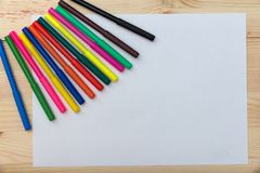 Colored felt-tip pens on a wooden table stock images