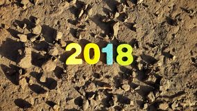 Colored number 2018 on the lunar surface Stock Images