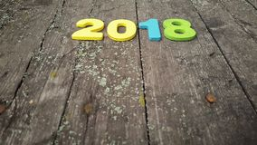 Colored figures to form the number 2018 on wooden background Stock Photo