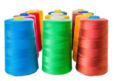 Colored fine thread bobbins. On white Stock Photos