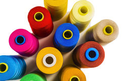 Colored fine thread bobbins Royalty Free Stock Images