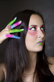 Colored fingers. Girl with colorful face painting and painted fingers Royalty Free Stock Image