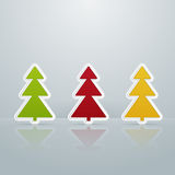 Colored Fir-Trees Object. Set of Four. Set of colorful Christmas trees standing in the mirror floor Royalty Free Stock Images