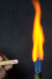 Colored Fire. Caused by an element. Sodium Na causes a yellow-orange color Royalty Free Stock Photography