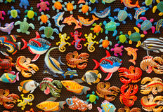 Colored fishes. A board wiht a lot of colored fishes Stock Photography