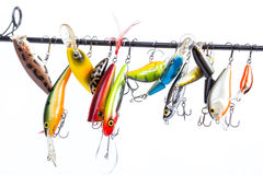 Colored fishing bait wobblers be suspended on rod`s blank Royalty Free Stock Photos