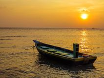 Colored fishing boat in the Maldives at sunset Royalty Free Stock Photos