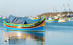 Colored fishing boats, Malta. Colored Fishing boats in  Marsaxlokk harbor, Malta Royalty Free Stock Photography