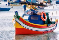 Colored Fishing boats in  Marsaxlokk harbor, Malta Royalty Free Stock Images