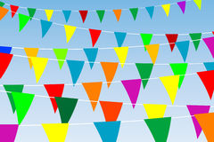 Colored flags. Triangular flags on rope Stock Photos