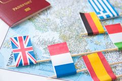 Colored flags of Europian countries and foreign passport on a map: France, Italy, England UK, Spain, Greece. Travel destination planning concept stock photos