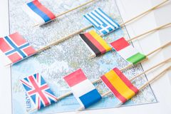 Colored flags of Europian countries on a map: France, Italy, England UK, Spain, Greece, travel destination planning concept.  stock photo