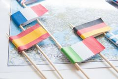 Colored flags of Europian countries on a map: France, Italy, England UK, Spain, Greece, travel destination planning concept.  stock photography