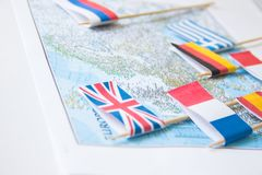 Colored flags of Europian countries on a map: France, Italy, England UK, Spain, Greece, travel destination planning concept.  royalty free stock photos