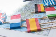 Colored flags of Europian countries on a map: France, Italy, England UK, Spain, Greece, travel destination planning concept.  royalty free stock photography