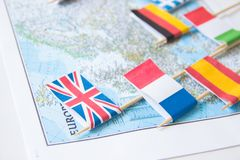 Colored flags of Europian countries on a map: France, Italy, England UK, Spain, Greece, travel destination planning concept.  royalty free stock photo
