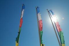 Colored flags. In front of the sun Stock Photo