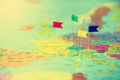 Colored flags, pushpins, thumbtack pinned on map of europe. Copy space, travel concept.  Stock Images