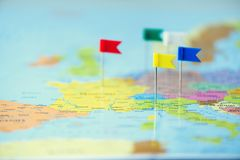 Colored flags, pushpins, thumbtack pinned on map of europe. Copy space, travel concept.  Stock Photo