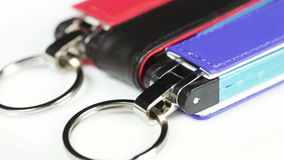 Colored flash drives. On white surface rotates group flash drives stock video