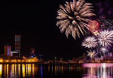 Colored flashes of fireworks over the city pond of Yekaterinburg in the city center Stock Photography