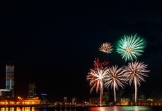 Colored flashes of fireworks over the city pond of Yekaterinburg in the city center Royalty Free Stock Image