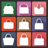 Colored flat icons with silhouettes of  fashion women's handbag Royalty Free Stock Image