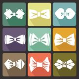 Colored flat icons with white silhouettes of bow tie Stock Images