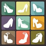 Colored flat icons with white silhouettes of  high-heeled shoes Royalty Free Stock Photography