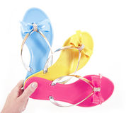 Colored flip-flops in hand Royalty Free Stock Photo