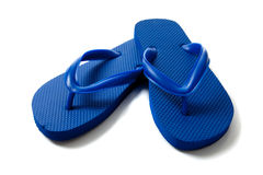 Colored flipflops on a white background. A pair of blue flipflops on a white background royalty free stock image