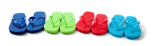 Colored flipflops on a white background Royalty Free Stock Images