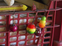 Colored floats with hooks for catching mullet stock images