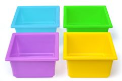 Colored flower pots. Against white background Royalty Free Stock Photography