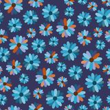 Colored flowers on a blue background. Seamless pattern Royalty Free Stock Images