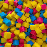 Colored foam rubber cubes background Stock Photos