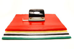Colored folders and punch Royalty Free Stock Image