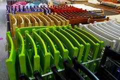 Colored folding textured chairs. In store stock photography