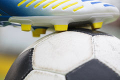 Kick-off. Colored football shoe before kick-off Stock Photography