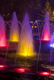 Colored fountain. At night in the city Royalty Free Stock Photo