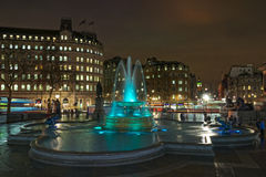 Colored fountain at Trafalgar square. View on the fountain at Trafalgar Square, in front of the National Gallery, and along the Whitehall street, from the lion Stock Photography