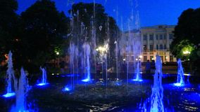 Colored fountains in city park stock video