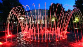 Colored fountains in city park stock video footage