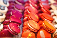 Colored french macaroons in a shop window