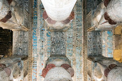 Colored frescoes on the ceiling of an ancient temple. In Egypt Stock Photos