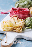 Colored fresh homemade pasta tagliatelle Royalty Free Stock Photography